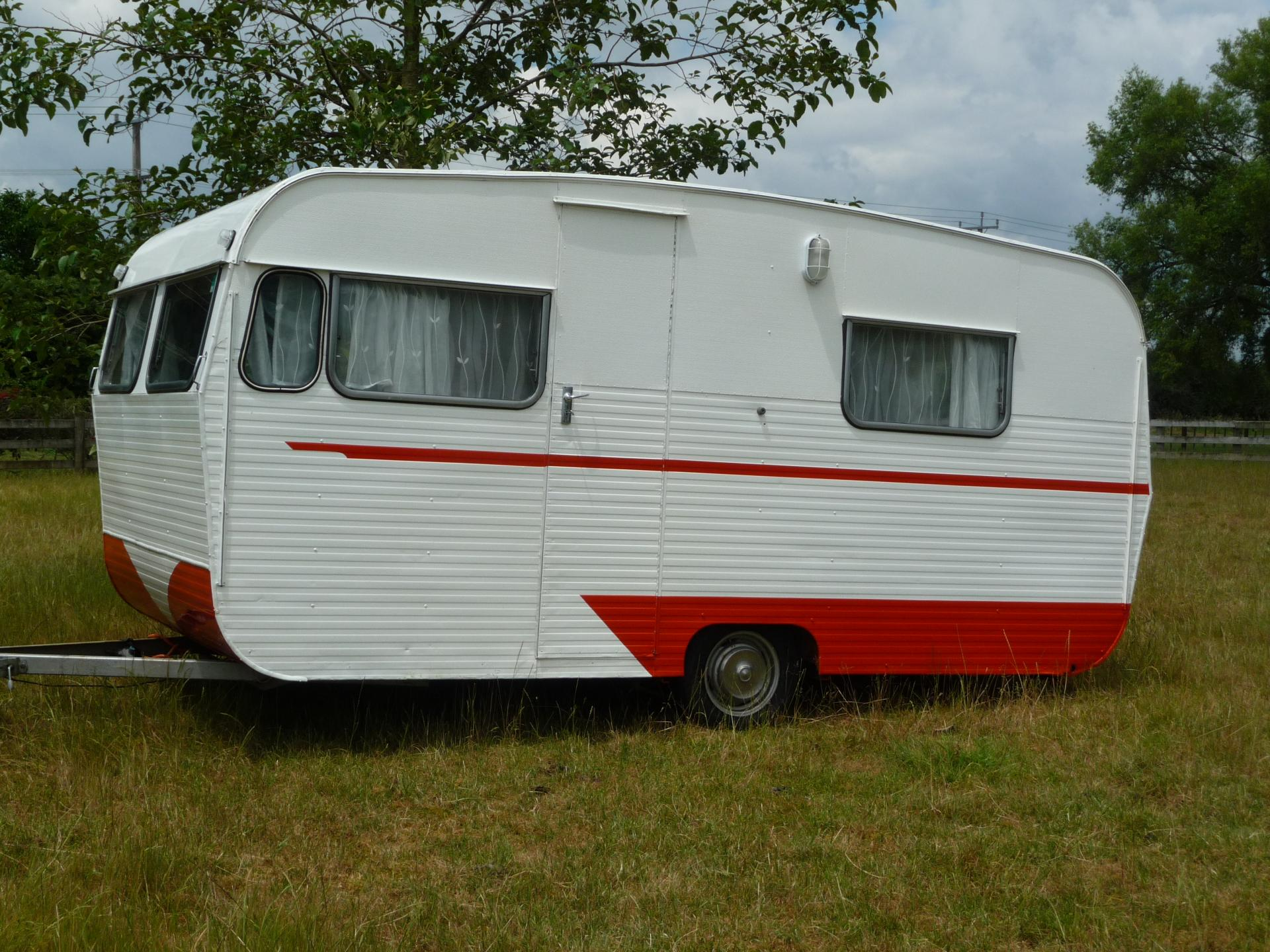 White and red refurbished caravan